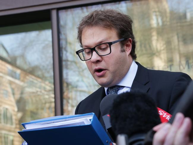 Legal representative ... Rolf Harris' lawyer Daniel Berke read a statement outside court in March 2016. Picture: Ella Pellegrini