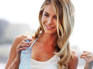 Model Jennifer Hawkins during shooting of a Mount Franklin Lightly Sparkling Water advertising campaign at Bondi Icebergs at Bondi Beach, Sydney.