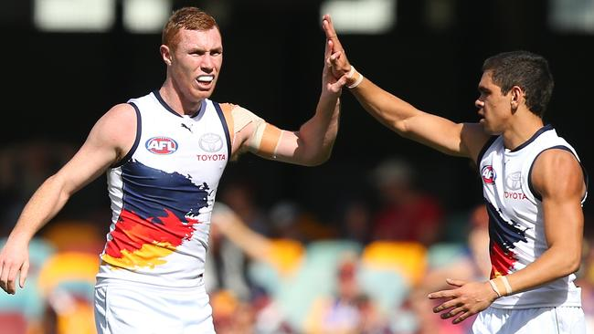 Tom Lynch had started well before ducking into a tackle and hurting his neck. Teammate Charlie Cameron (right) was also lively in the commanding win. Picture: Getty Images