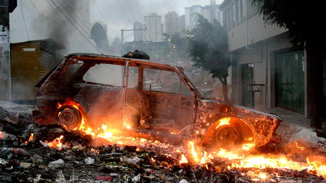 Residents of the Paraisópolis Favela burn a car to protest the killing of an innocent man by military police. The police say the resident was a criminal fugitive. Photo: Alex Vieira