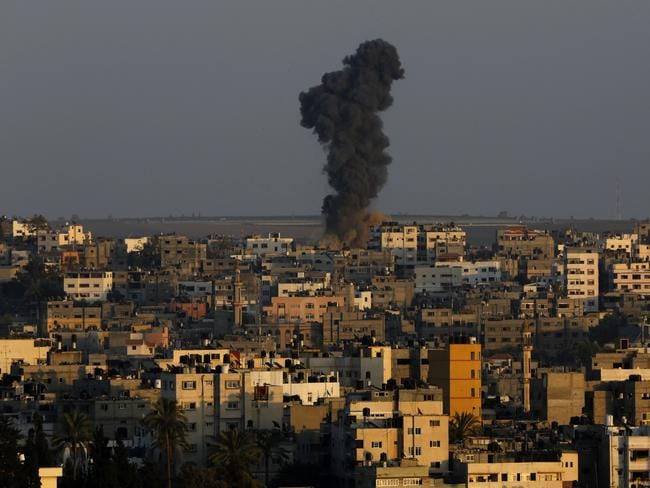 Battle rages again ... Smoke and dust rise after an Israeli strike hit Gaza City in the northern Gaza strip.
