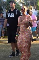 Amber Rose was spotted with friends in the gardens during Coachella. The model and mom looked sexy in a simple floral cutout dress. Picture: BackGrid