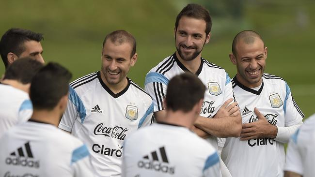 Javier Mascherano (R) forward Gonzalo Higuain (C back) and forward Rodrigo Palacio.