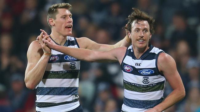 Mitch Brown celebrates a goal with Mark Blicavs.