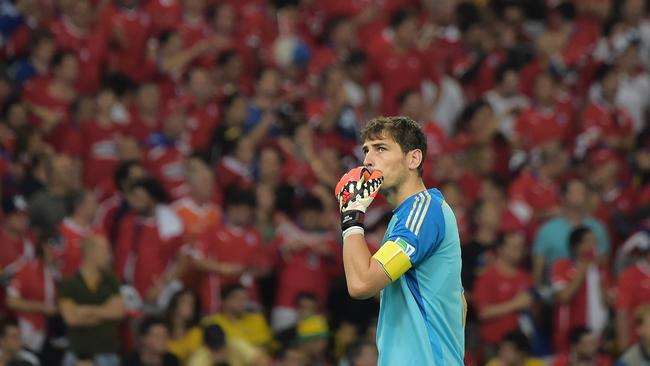 "Spain's goalkeeper and captain Iker Casillas. ""What have I done""?"