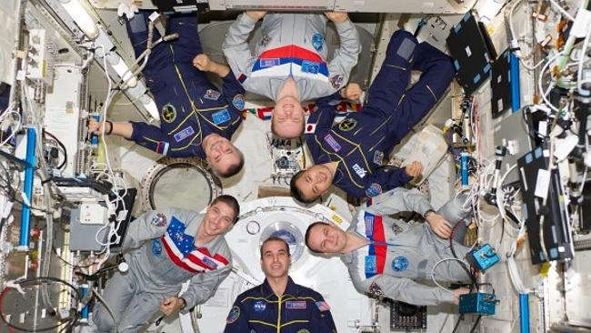 All good up here. The multi-national crew onboard the International Space Station pose for a picture. Source: NASA