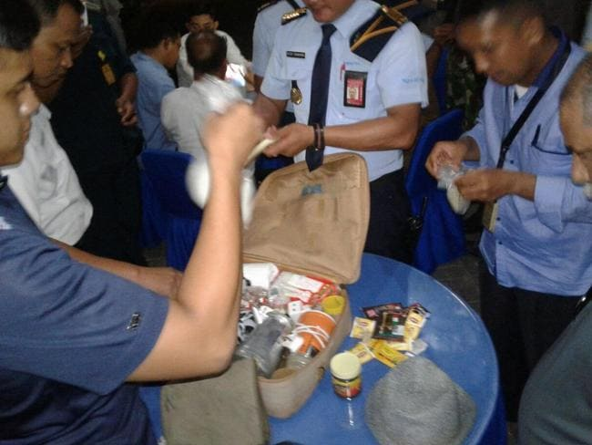 Luggage is searched at an airport in Bali after a hoax bomb threat. Picture: Supplied