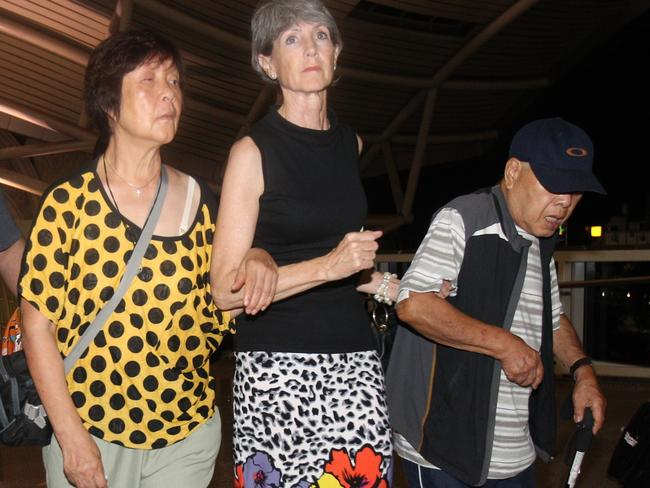 Heartbreak ... Andrew Chan's mother Helen and father Ken, accompanied by Australian Consul in Bali Majell Hind, arrive at Bali Airport on their way to Australia. Picture: News Corp Australia