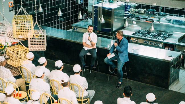 Kensington Street Social and Street Social group chef Jason Atherton (left) and Luke Mangan (blue suit) address TAFE students as part of Mangan's 2016 Inspired Series. Supplied