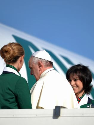 To the Holy Land he goes... Pope Francis boards the plane for Jordan. Picture: Filippo Monteforte
