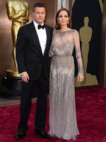 Brad Pitt, left, and Angelina Jolie on the red carpet at the Oscars 2014. Picture: Getty
