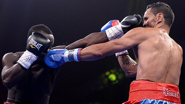 Anthony Mundine and Joshua Clottey both land snapping jabs during their bout.