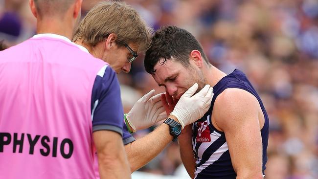Hayden Ballantyne gets checked by club doctors.