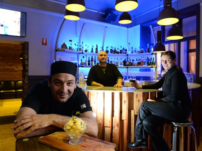 Kaffana Bar in Peel Street Adelaide. Co owner and chef Nick Vajic with brother Peter Vujic and Vida Beborovic at the bar. Picture Campbell Brodie.