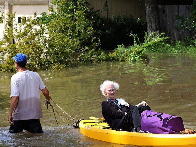 A woman is evacuated on a canoe as people escape flood waters in Lakeside Estate in Houston. Picture: AFP