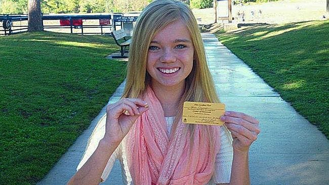 Diamonds are this girl's best friend ... Tana Clymer, 14, with her ticket for the 3.85-carat canary diamond she found the Crater of Diamonds State Park. (AP Photo/Crater of Diamonds State Park)