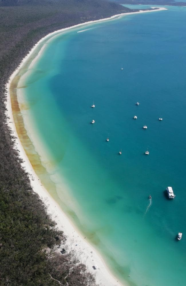 An aerial image over Whitehaven Beach in the Whitsundays. Picture: Lachie Millard