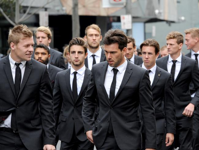 Collingwood players after the funeral. Picture: AAP