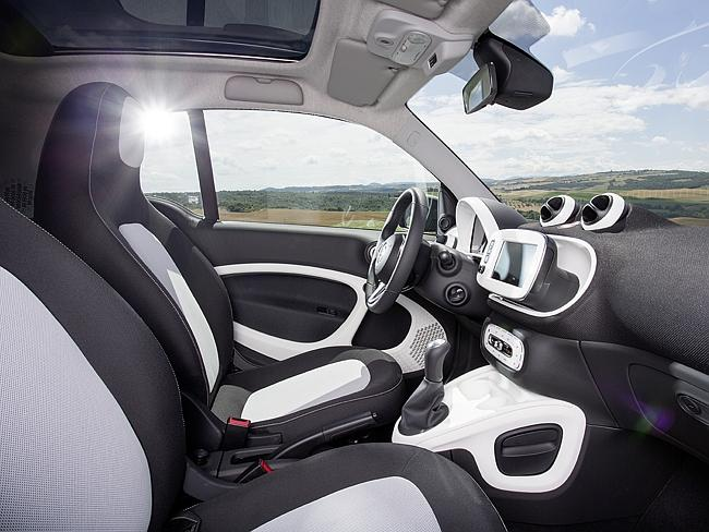 Modern interior ... the car boasts a collision warning system and iPad style cabin control screen.