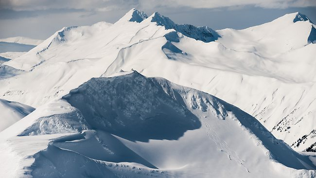 Those tiny dots in the right bottom corner. That's the snowboarders. Picture: Last Fronteir Heliskiing