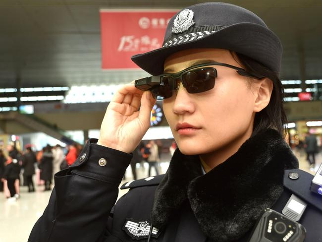 Chinese police are sporting high-tech sunglasses that can spot suspects in a crowded train station, the newest use of facial recognition technology that has drawn concerns among human rights groups. Picture: AFP