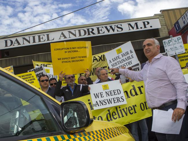 Taxi drivers rally at Daniel Andrews' electorate office in Noble Park. Picture: Richard Serong