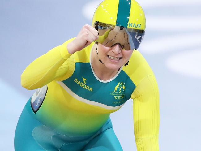 Stephanie Morton of Australia celebrates winning the Women - Commonwealth Games Day 4 Medal Tally, Swimming, Athletics Results, Kerri Pottharst Racial Comment's Keirin gold