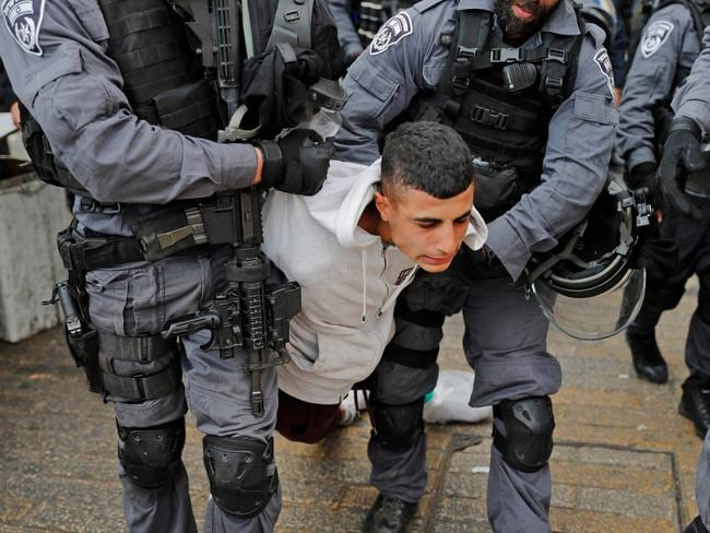 Israeli security forces detain a Palestinian youth as they patrol Jerusalem's Old City. Picture: AFP