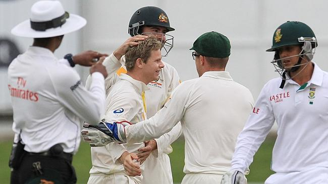 Steve Smith celebrates after dismissing Quinton de Kock (R).