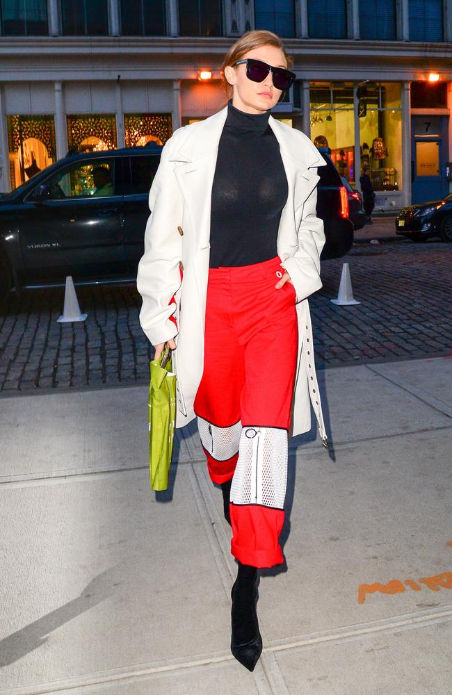 Gigi Hadid styled her blood-red trackies with a pointy-toed heel. Picture: Raymond Hall/GC Image