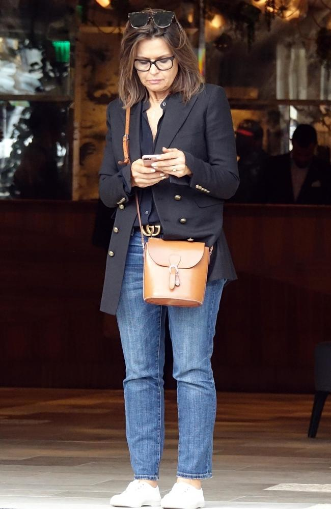 She was glued to her iPhone outside her LA hotel. Picture: BackGrid