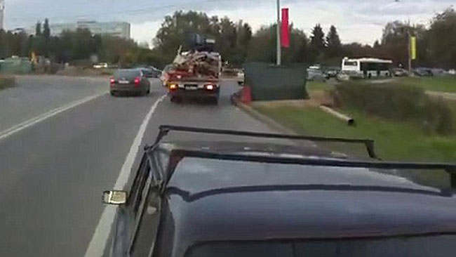 Wham! Volkov runs his bus right intot he car's rear-end. Picture: Alexei Volkov, via YouTube