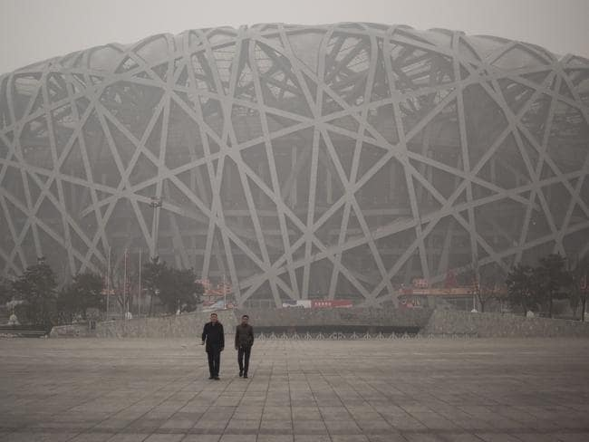 Smog is a familiar feature around the Birds Nest Stadium in Beijing. Picture: Fred Dufour/AFP