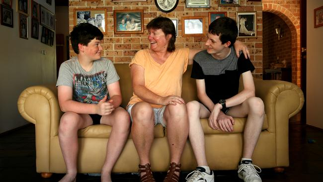 NSW's Rosemary Fox, pictured with her sons Joshua and Daniel, has signed up to the Big Health Insurance Switch. Picture: Sam Ruttyn