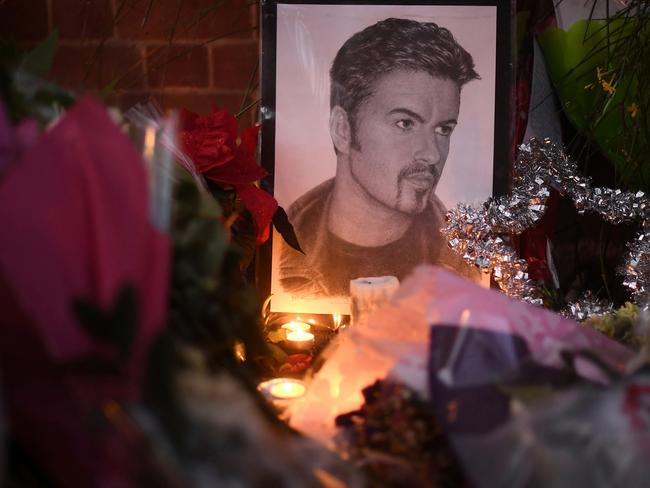 Flowers and tributes are left outside the Oxfordshire home of British pop singer George Michael. Picture: Carl Court/Getty Images