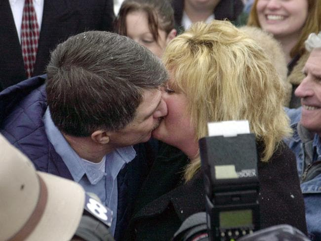 Clarence Elkins kisses Melinda outside Mansfield Correctional Institution following his release from prison on 15 December, 2005.