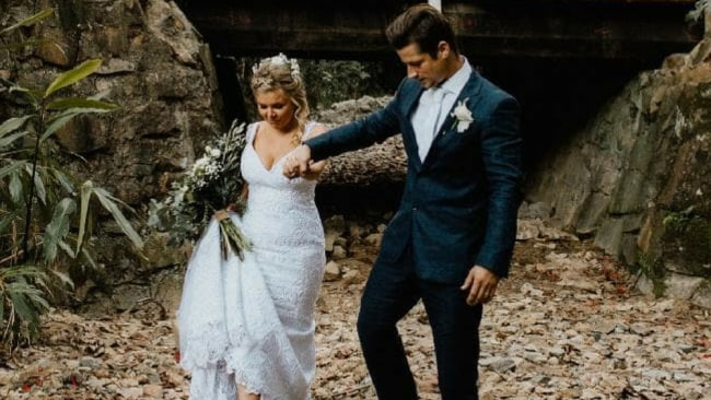 The couple had photos in the bushland surrounding the wedding venue. Picture: Bulb Creative Source: Supplied