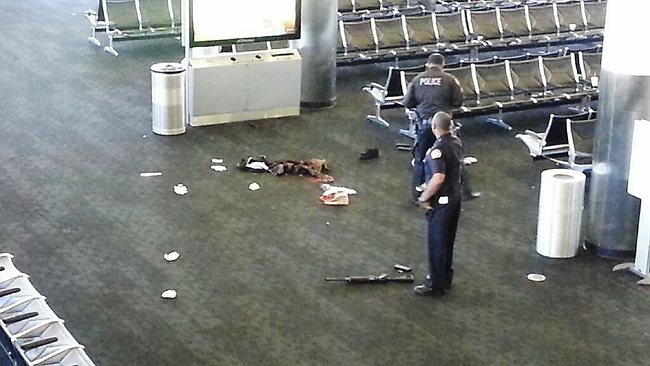 A police officers stansd near an unidentified weapon in Terminal 3 of the Los Angeles International Airport. Picture: AP