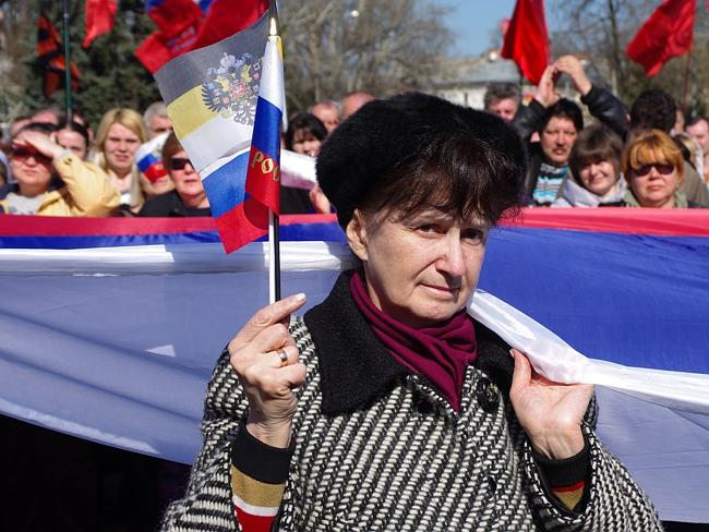 Divided loyalties ... a woman holds a Russian flag as pro-Russian activists take part in a rally in Odessa. Picture: ALEXEY KRAVTSOV