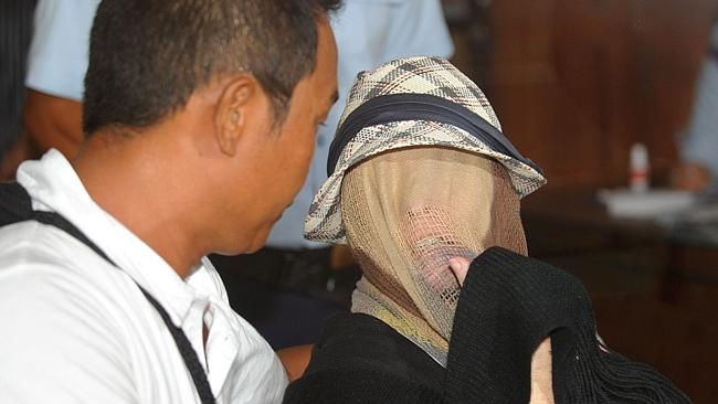 Schapelle Corby (R) sits at a correction bureau in Denpasar after more than nine years behind bars. AFP / SONNY TUMBELAKA