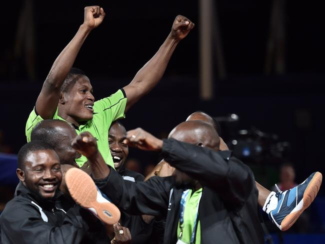 Nigeria's Ojo Onaolapo celebrates his victory with teammates.