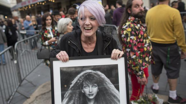 Fans arrive at the Hammersmith Apollo ahead of the second live performance by the singer Kate Bush in 35 years on August 27, 2014 in London, England.