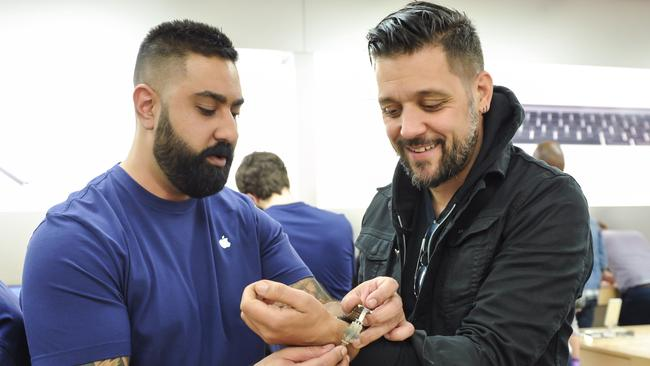 Trying out tech ... An Apple Store employee puts a Watch on Canadian TV personality George Stroumboulopoulos. Picture: George Pimentel/Getty Images
