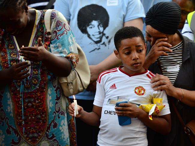 Emotions run high at a candlelit vigil outside Notting Hill Methodist Church near Grenfell Tower. Picture: Chris J Ratcliffe/Getty Images