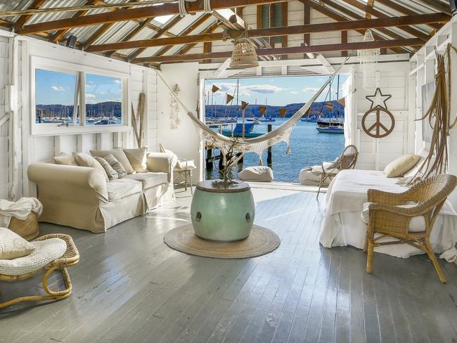 A boatshed with a dreamy interior and even dreamier view.