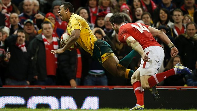 Australia's Kurtley Beale dives to score the matchwinning try against Wales at the Millennium Stadium in Cardiff. Picture: Matt Dunham