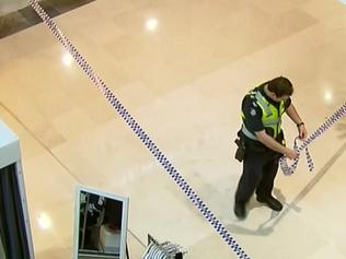 The scene where a beautician has been savagely wounded by an axe-wielding man believed to be her husband in an attack at Westfield Fountain Gate. Picture: Nine News