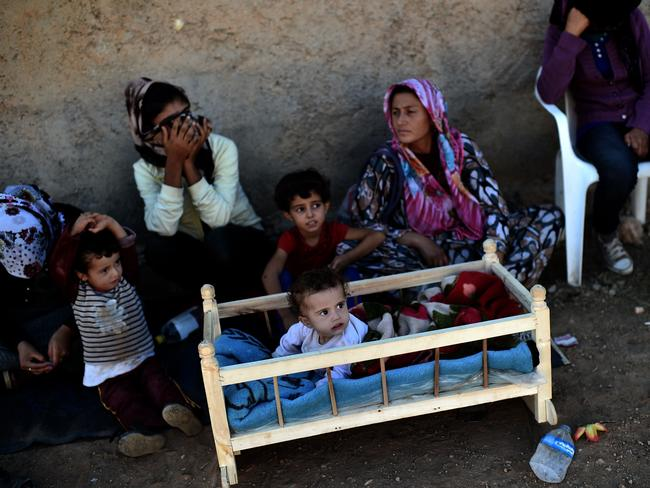Displaced ... Kurdish refugees evacuate the Syrian town of Ain al-Arab as Islamic State militants move in. Picture: AFP