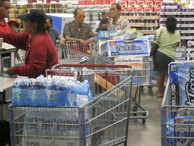 Shoppers in Hawaii stock up on cases of bottled water and other supplies.