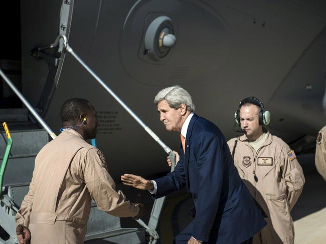 Iraq bound ... US Secretary of State John Kerry, centre, greets the crew as he boards a plane headed to Iraq at Jordan's Queen Alia International Airport, in Amman, Jordan.